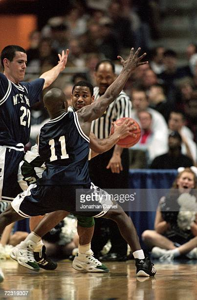 Charlie Bell of Michigan State looks for help while Gregory Harris and Tony Hayden of Mount St Mary's double team him during the first round of the...