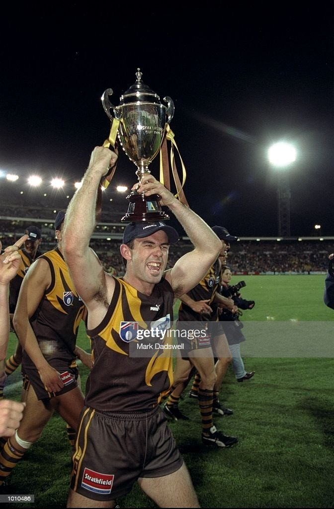 Daniel Harford holds aloft the 1999 AFL Ansett Cup after the Hawthorn win over Port Adelaide at Waverley Park, Hawthorn, Victoria, Australia. \ Mandatory Credit: Mark Dadswell /Allsport