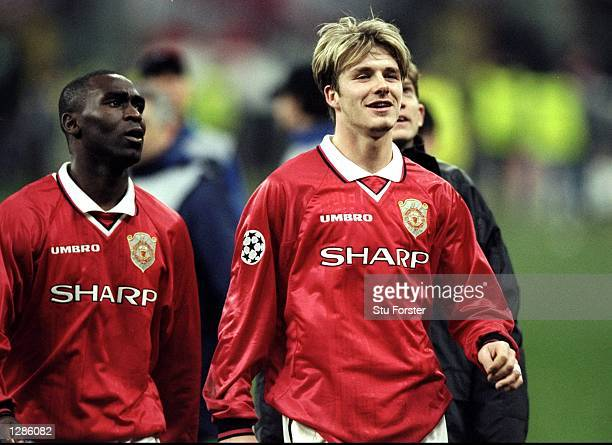 David Beckham and Andy Cole of Manchester United walk off the pitch after the UEFA Champions League quarterfinal second leg match against Inter Milan...
