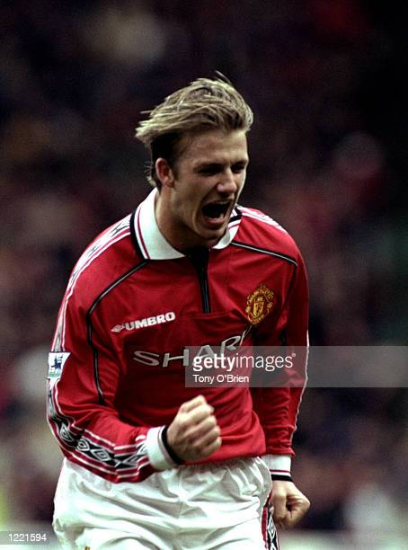 David Beckham of Manchester United celebrates during the FA Carling Premiership match against Everton played at Old Trafford in Manchester England...