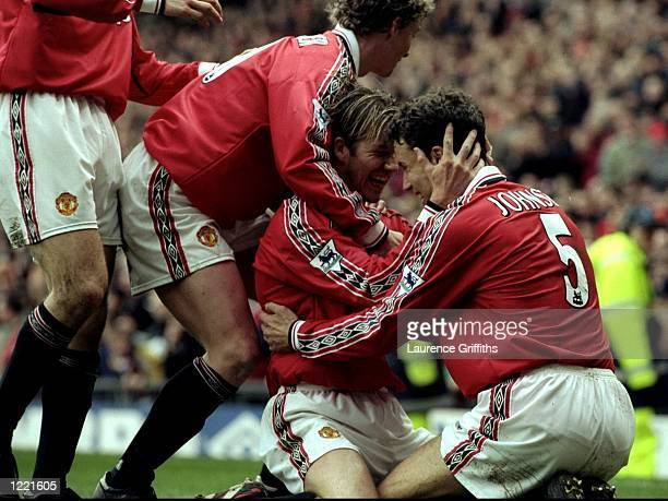 David Beckham of Manchester United celebrates with the rest of the Mancehster United team during the FA Carling Premiership match against Everton...