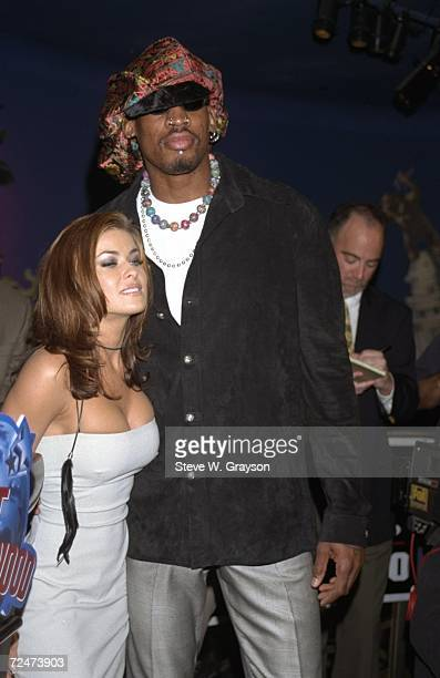 Dennis Rodman stands with his wife Carmen Electra during a press conference at the Planet Hollywood restaurant in Hollywood California Mandatory...