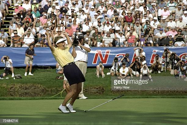 Dottie Pepper celebrates victory on the 18th hole during the Nabisco Dinah Shore Classic at the Mission Hills Country Club in Rancho Mirage...