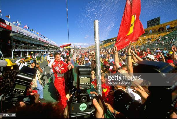 Ferrari's Eddie Irvine celebrates his maiden victory in the Formula One Australian Grand Prix at Albert Park in Melbourne. \ Mandatory Credit:...