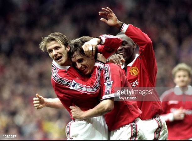 Gary Neville of Manchester United is congratulated by team mate David Beckham after scoring against Everton in the FA Carling Premiership match at...