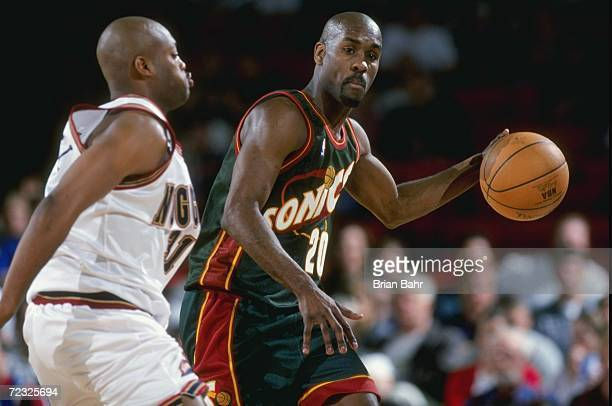 Gary Payton of the Seattle SuperSonics in action during the game against the Denver Nuggets at the McNichols Arena in Denver Colorado The Nuggets...