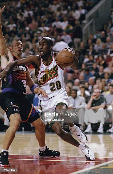 Gary Payton of the Seattle SuperSonics in action during the game against the Phoenix Suns at the Key Arena in Seattle Washington The Suns defeated...