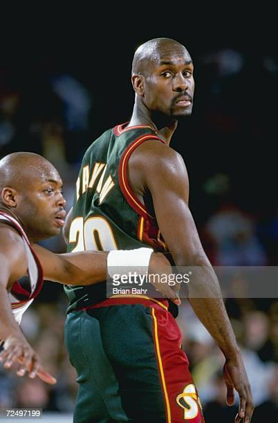 Gary Payton of the Seattle SuperSonics looking on during the game against the Denver Nuggets at the McNichols Sports Arena in Denver Colorado The...