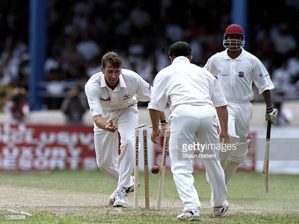 Glenn McGrath of Australia runs out Suruj Raganooth of the West Indies in the First Test at the Queens Park Oval in Port of Spain in Trinidad....