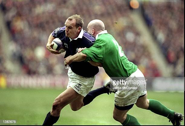 Gregor Townsend of Scotland is tackled by Keith Wood of Ireland in the Five Nations match at Murrayfield in Edinburgh Scotland won 3013 Mandatory...