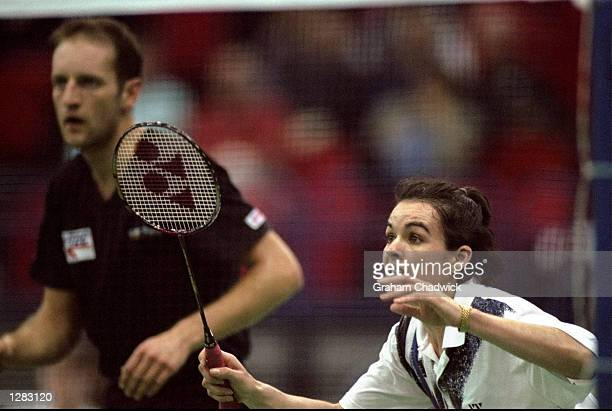 Jo Goode and Simon Archer of England in action during the Yonex All England Open Badminton Championships at the National Indoor Arena in Birmingham...