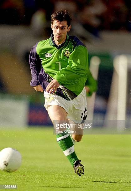 Keith Gillespie of Northern Ireland in action during the European Championships Qualifier against Germany at Windsor park, in Belfast, Northern...