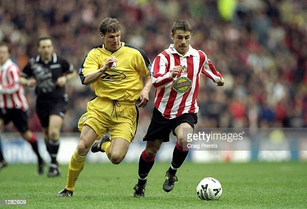 Kevin Phillips of Sunderland takes on Neil Cox of Bolton Wanderers in the Nationwide Division One match at the Stadium of Light in Sunderland England...