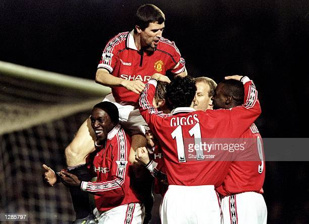 Manchester United celebrate Dwight Yorke's goal against Chelsea in the FA Cup quarterfinal replay at Stamford Bridge in London United won 20...