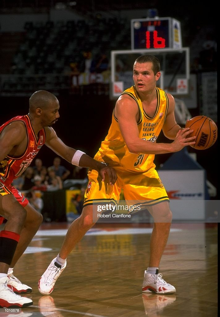 Matt Shanahan of the Brisbane Bullets holds the ball away from Marcus Timmons of the Melbourne Tigers, during the 1999 NBL game at the Melbourne Sports & Aquatic Centre, Albert Park, Melbourne, Australia. \ Mandatory Credit: Robert Cianflone/Allsport