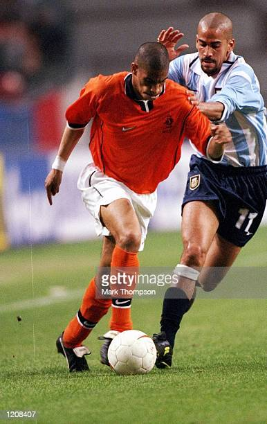 Michael Reiziger of Holland takes on Juan Veron of Argentina during the International Friendly at the Amsterdam ArenA in Holland Mandatory Credit...