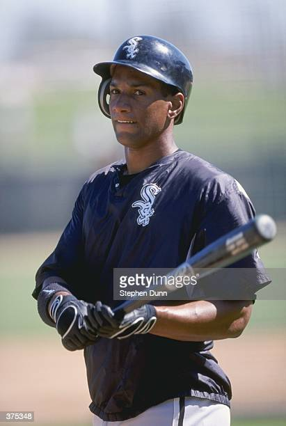 Outfielder Darrin Jackson of the Chicago White Sox holds a bat during the Spring Training game against the Chicago Cubs at the HoHoKam Park in Mesa...