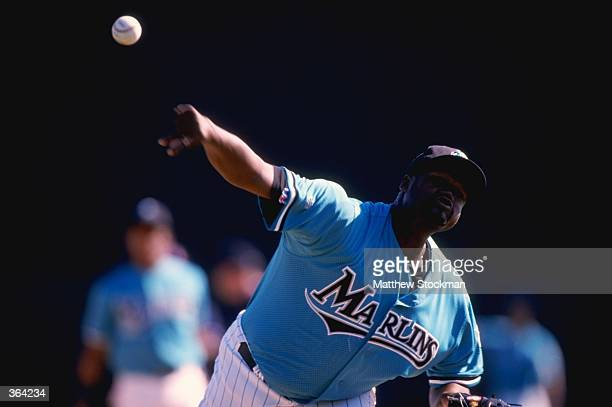 Pitcher Antonio Alfonseca of the Florida Marlins throws during a Spring Training game against the Houston Astros at the Space Coast Stadium in...