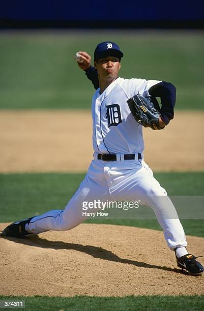 Pitcher Masao Kida of the Detroit Tigers windsback to throw during the Spring Training game against the Cleveland Indians at the Joker Marchant...