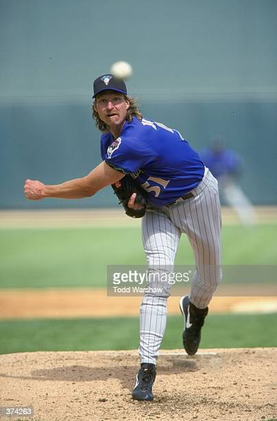 Pitcher Randy Johnson of the Arizona Diamondbacks throws during the Spring Training game against the Chicago White Sox at the Tucson Electric Park in...