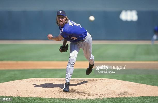 Pitcher Randy Johnson of the Arizona Diamondbacks winds-up to throw during the Spring Training game against the Chicago White Sox at the Tucson...