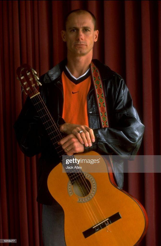 Portrait of Marathon runner Steve Moneghetti of Australia relaxing with his guitar in his home in Ballarat, Victoria, Australia. \ Mandatory Credit: Jack Atley /Allsport