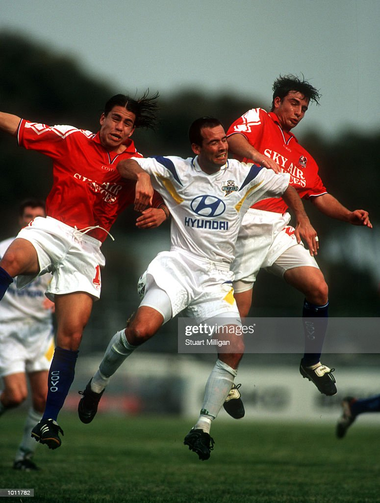 Rody Vargas and Joey Rajher of Melbourne Knights attempt to stop David Pilic of Brisbane Strikers during the match between Melbourne Knights v Brisbane Strikers at Melbourne Knights Stadium,Melbourne Australia. Mandatory Credit: Stuart Milligan/ALLSPORT