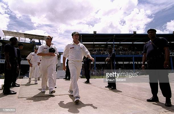 Steve Waugh leads out Australia for the First Test against the West Indies at the Queens Park Oval in Port of Spain in Trinidad Australia won by 312...