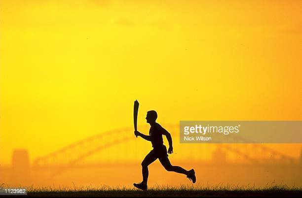 The 2000 Sydney Olympic Games Torch silhouetted against Sydney Harbour Bridge Mandatory Credit Nick Wilson /Allsport