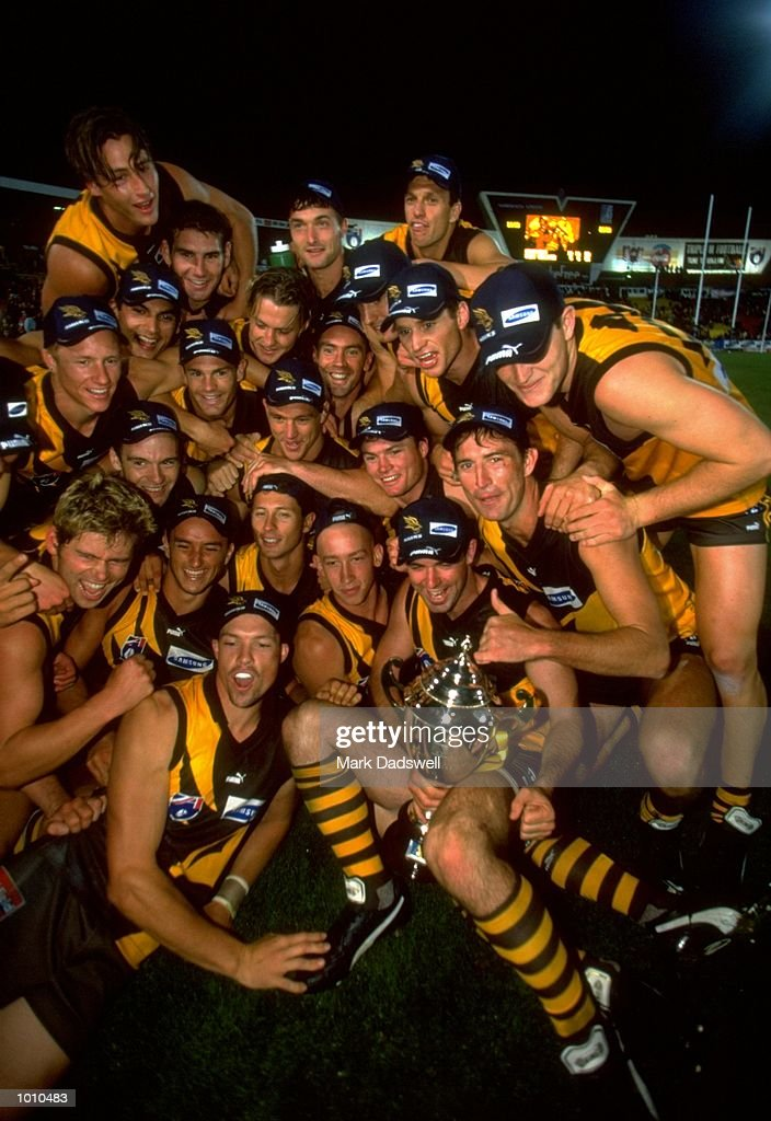 The Hawthorn team celebrate their win over Port Adelaide claiming the 1999 AFL Ansett Cup Grand Final. \ Mandatory Credit: Mark Dadswell /Allsport