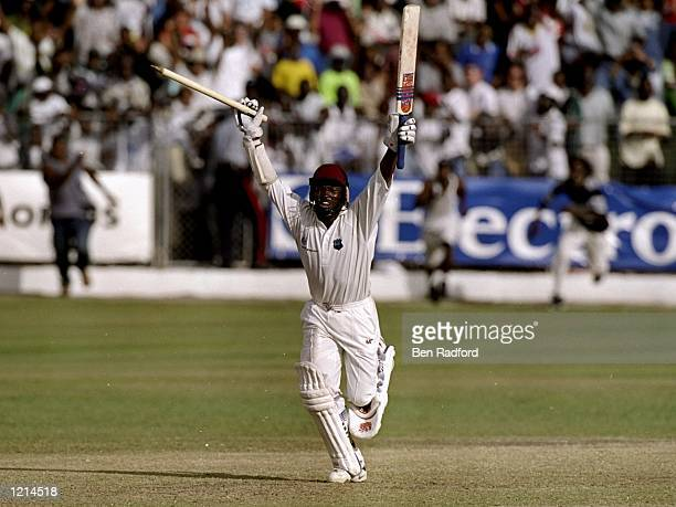 West Indies captain Brian Lara celebrates after hitting the winning runs in the Third Test against Australia at the Kensington Oval in Bridgetown...