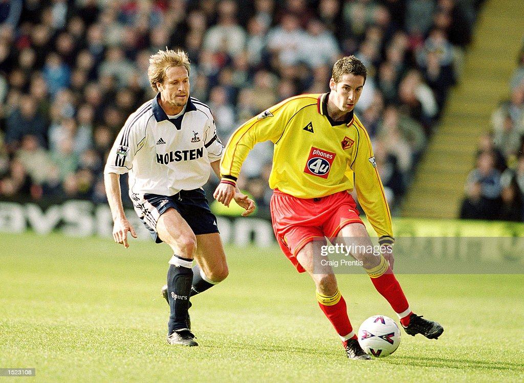 Allan Smart of Watford is watched by John Scales of Tottenham Hotspur during the FA Carling Premiership match at Vicarage Road in Watford, England. The game ended 1-1. \ Mandatory Credit: Craig Prentis /Allsport