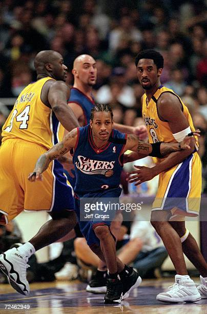 Allen Iverson of the Philadelphia 76ers moves between Shaquille O''Neal and Kobe Bryant of the Los Angeles Lakers during their game at Staples Center...