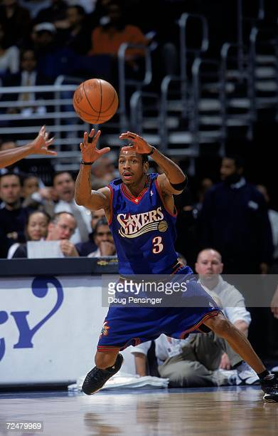 Allen Iverson of the Philadelphia 76ers passes the ball during a game against the Washington Wizards at the MCI Center in Washington DC The 76ers...