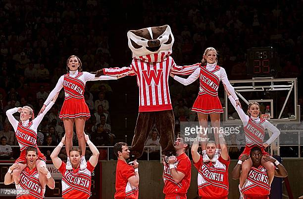 Bucky Badger gets a lift from the Wisconsin cheerleaders during the second round of the NCAA West tournament at the Huntsman Center in Salt Lake City...