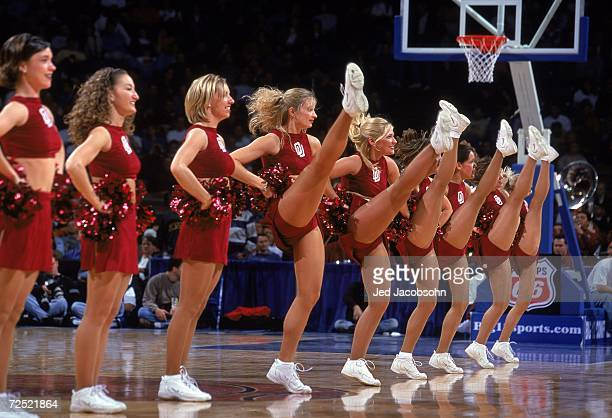 Cheerleaders of the Oklahoma Sooners kick up their heels on the court during the Big 12 Tournament SemiFinals against the Texas Longhorns at the...