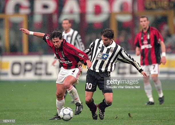 Demetrio Albertini of AC Milan battles with Alessandro Del Piero of Juventus during the Serie A match at the San Siro in Milan Italy Milan won 20...