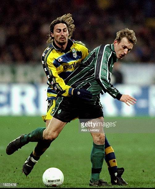 Dino Baggio of Parma clashes with Andreas Herzog of Werder Bremen during the UEFA Cup fourth round second leg game between Werder Bremen and Parma at...