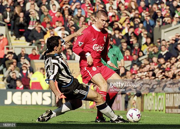 Dominic Matteo of Liverpool is challenged by Nikolas Dabizas of Newcastle United during the FA Carling Premiership match at Anfield in Liverpool...