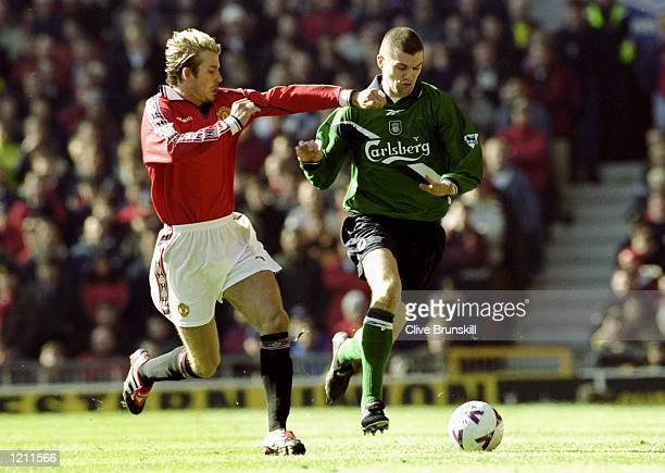 Dominic Matteo of Liverpool takes on David Beckham of Manchester United during the FA Carling Premiership match at Old Trafford in Manchester England...