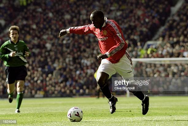 Dwight Yorke of Manchester United in action during the FA Carling Premiership match against Liverpool at Old Trafford in Manchester England The match...