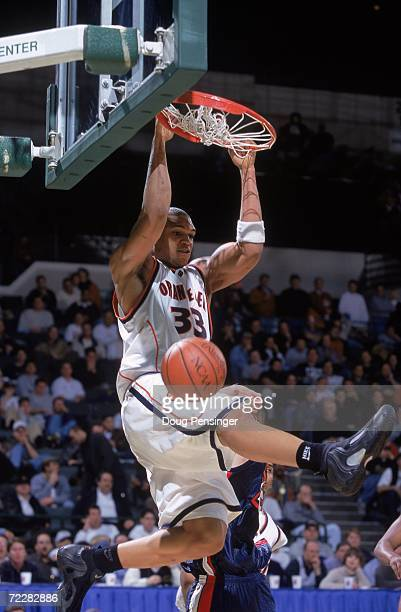 Etan Thomas of the Syracuse Orangemen makes a slam dunk during the first round of the NCAA Tournament Game against the Samford Bulldogs at the...