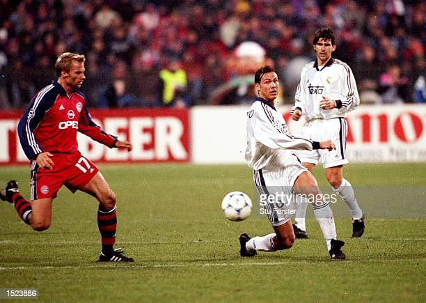 Fernando Redondo of Real Madrid is watched by Thorsten Fink of Bayern Munich during the UEFA Champions League group C match at the Olympiastadion in...