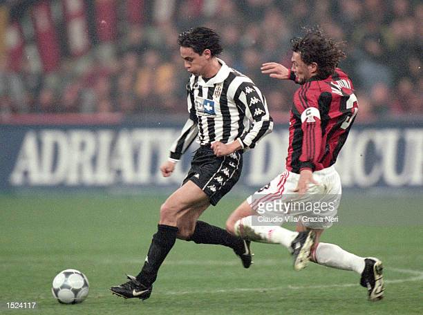 Filippo Inzaghi of Juventus is challenged by Paolo Maldini of AC Milan during the Serie A match at the San Siro in Milan Italy Milan won 20 Mandatory...