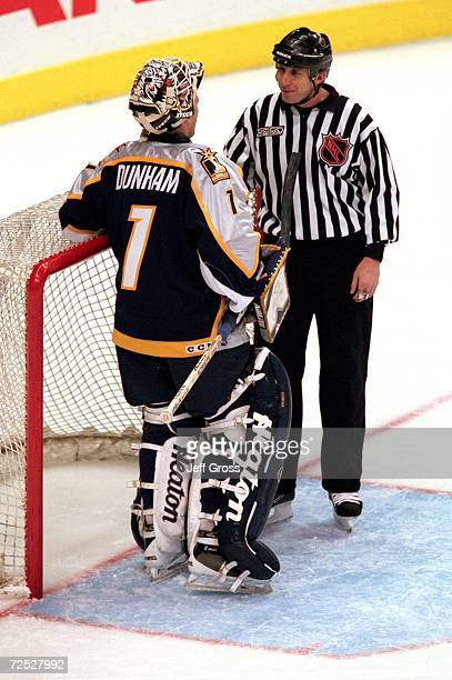 Goalie Mike Dunham of the Nashville Predators talks with a linesman at the net during the game against the the Los Angeles Kings at the Staples...