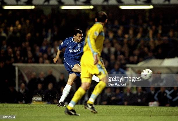 Gustavo Poyet of Chelsea scores the opening goal during the UEFA Champions League game between Chelsea and Lazio at Stamford Bridge in London The...
