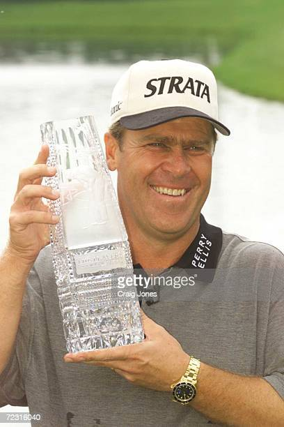 Hal Sutton holds the champions trophy after the final round of the Tournament Players Championship on Monday at the TPC at Sawgrass in Ponte Vedra...