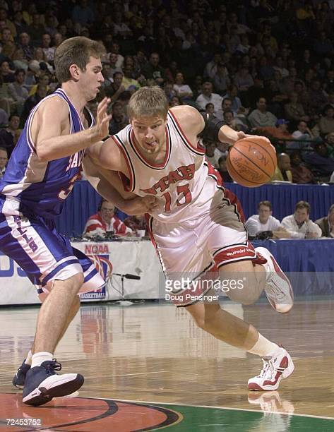 Hanno Mottola of the University of Utah tries to drive past Matt Baniak of Saint Louis University during the first round of the NCAA Tournment...