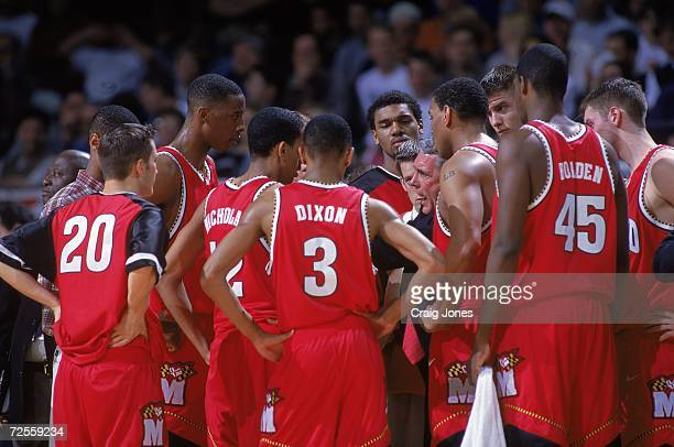 Head Coach Gary Williams of the Maryland Terrapins coaches the team in a huddle during the ACC Tournament Game against the Duke Blue Devils at the...