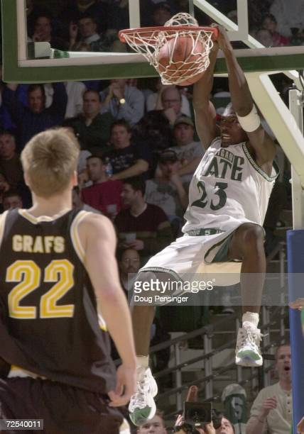 Jason Richardson of Michigan State University dunks on a breakaway as Raitis Graqfs of Valparaiso University can only watch during Round 1 of the...